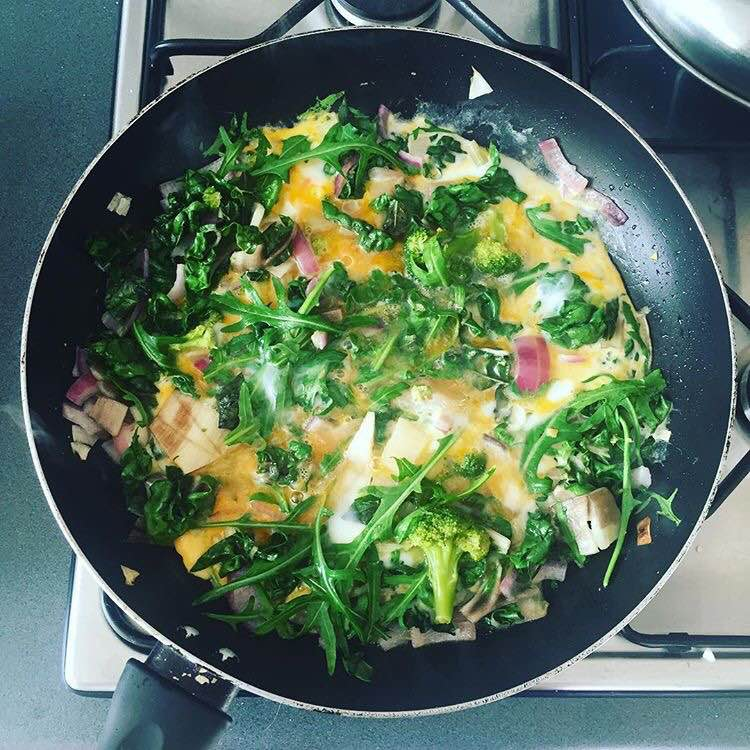 Spinach, kale, onion, free range organic eggs, broccoli and rocket - simple morning fry up.